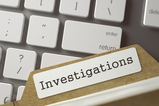 Sort Index Card with Investigations on laptop keyboard