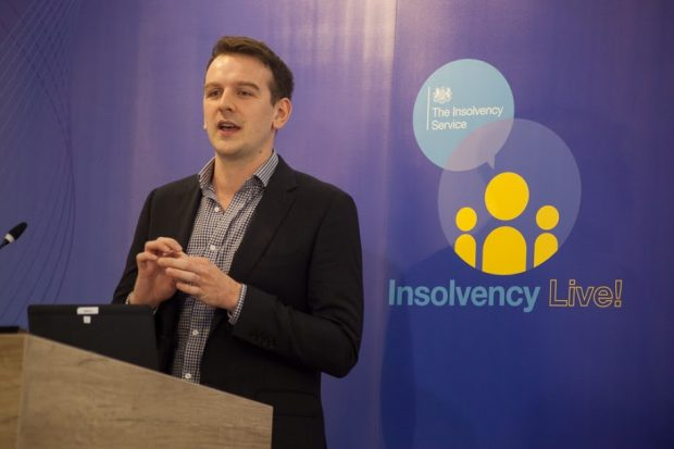 Daniel Kelly of the Money & Pensions Service speaking at a podium at the Insolvency Live! event