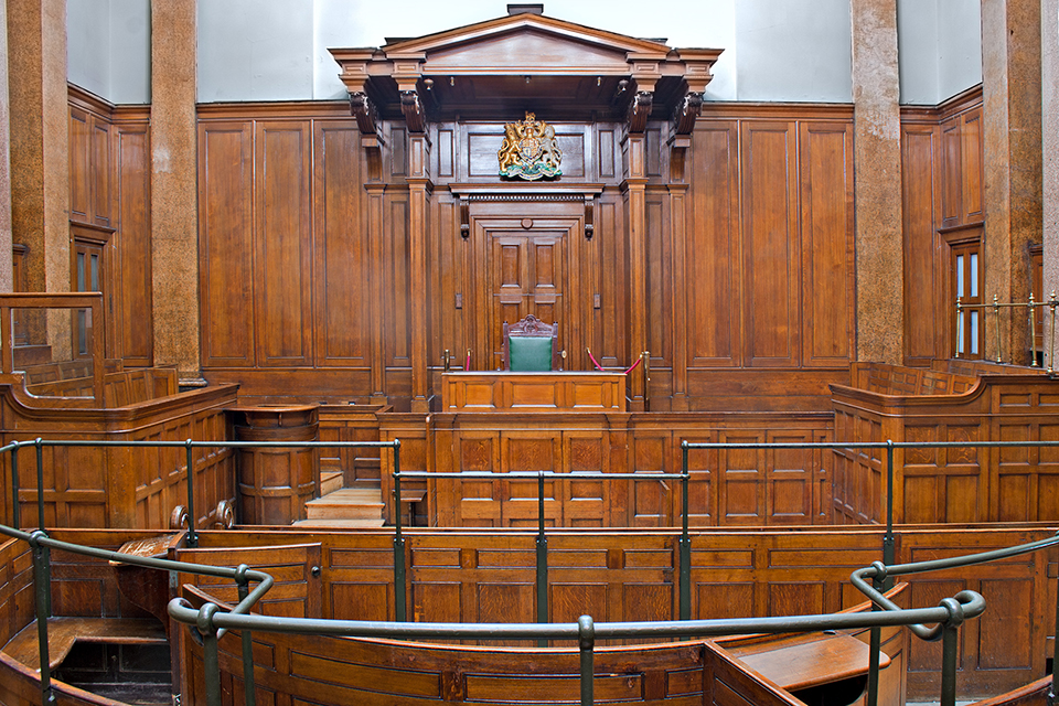 View of the inside of a wood-panelled court room