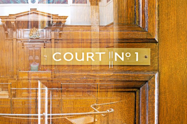 Wood panelling with court room sign