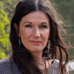 Image of Sarah next to a lake