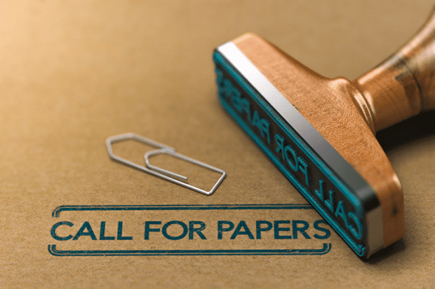 The phrase Call for Papers stamped on paper by a rubber stamp